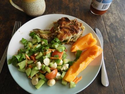 Salad, vegetarian lasagne and paw paw