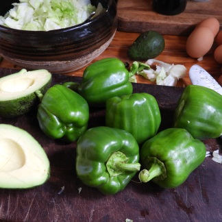 Capsicum, avocado, eggs, and lettuce going into the salads.